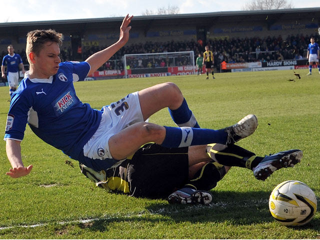 Burton's Anthony O'Connor tackles Chesterfield's Conor Townsend during the npower League Two match on March 30, 2013
