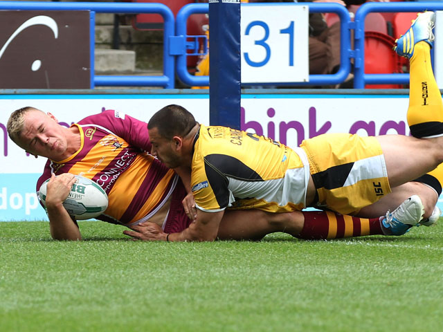 Huddersfield Giant's Ben Blackmore scores a try during the Super League match against Castleford Tigers on July 21, 2013