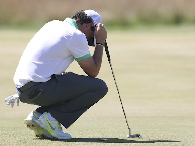 Rory McIlroy acts disappointed after a poor shot at the British Open on July 18, 2013