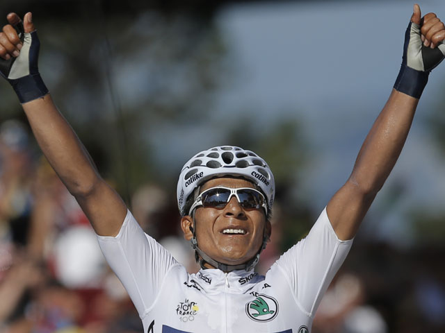 Nairo Alexander Quintana of Colombia crosses the finish line to win the 20th stage of the Tour de France on July 20, 2013