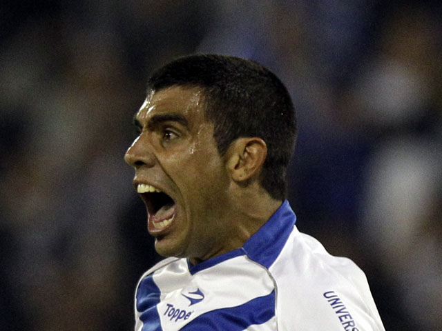Augusto Fernandez of Argentina's Velez Sarsfield celebrates after scoring against Colombia's Atletico Nacional on May 8, 2012