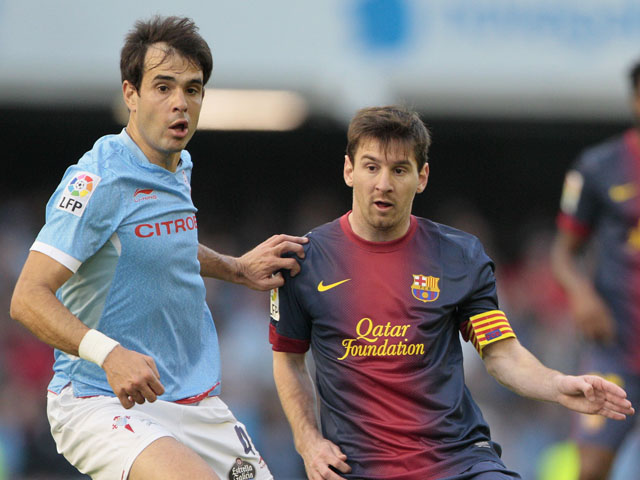Celta's Borja Oubina in action against Barcelona on March 30, 2013