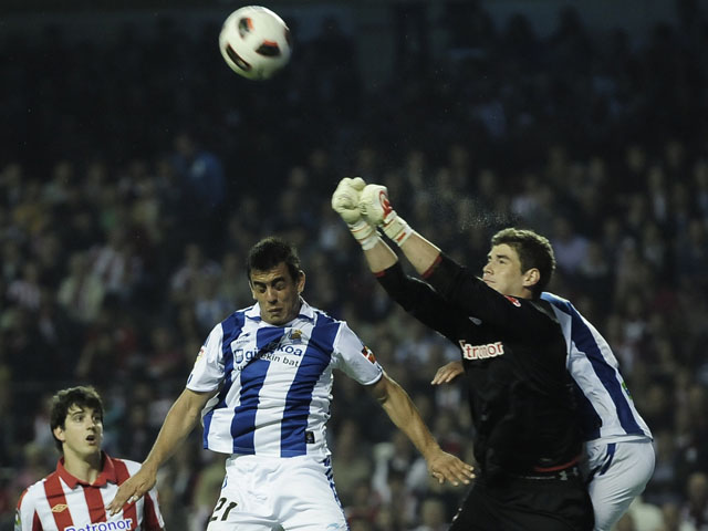 Real Sociedad's Diego Ifran jumps for the ball during the match against Athletic Bilbao on April 23, 2011