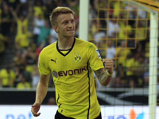 Dortmund's Marco Reus celebrates after scoring during the Super cup match on July 27, 2013