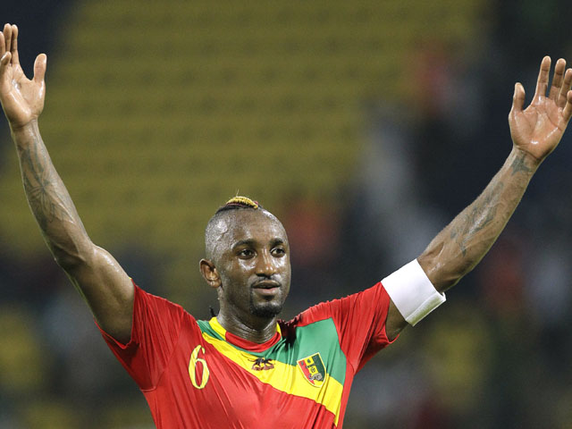 Guinea's captain Kamil Zayatte celebrates after his side defeated Botswana on January 28, 2012