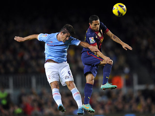 Celta Vigo's Mario Bermejo duels for the ball with FC Barcelona's Adriano on November 3, 2012