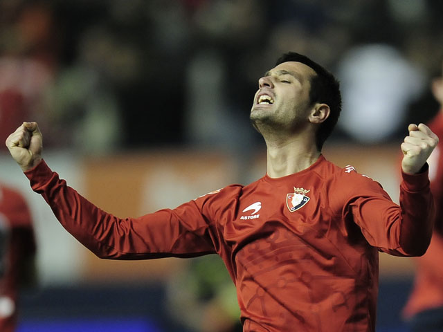 Osasuna's Miguel Flano celebrates after his team beat Real Madrid in the La Liga match on January 30, 2011