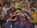 Barcelona's Lionel Messi celebrates with teammates on August 2, 2013