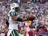 Calvin Pace of the New York Jets celebrates after recovering a fumble against the Washington Redskins on December 4, 2011