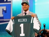 New York Jets' Dee Milliner holds up his jersey on April 25, 2013