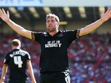 Wigan's Grant Holt celebrates after scoring his team's second goal during the match against Barnsley on August 3, 2013