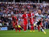 Derby's Johnny Russell scores the opener from the penalty spot during the match against Blackburn on August 4, 2013