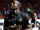 Wigan's Leon Barnett celebrates after scoring his team's third goal during the match against Barnsley on August 3, 2013