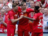 Jordan Henderson of Liverpool is congratulated by Steven Gerrard and Raheem Sterling after scoring the winning goal during the Steven Gerrard Testimonial Match on August 3, 2013