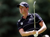 Webb Simpson in action during round one of the World Golf Championships on August 1, 2013