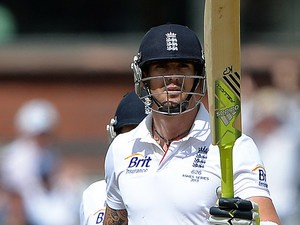 England's Kevin Pietersen raise his bat moments after reaching 50 runs during the third day of the third Ashes Test on August 3, 2013