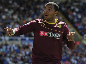 Watford's Troy Deeney celebrates after scoring the opening goal against Birmingham on August 3, 2013