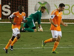 Houston Dynamo's Will Bruin celebrates his goal with team mate Boniek Garcia during the match against Columbus Crew on August 3, 2013