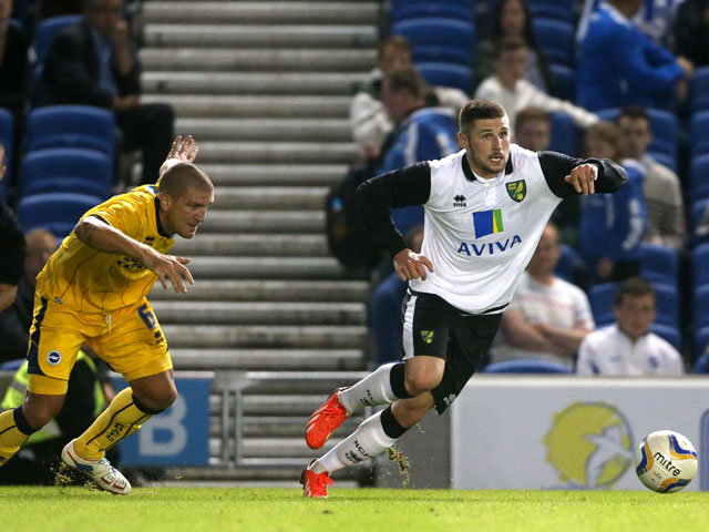 Norwich City's Gary Hooper gets away from Brighton & Hove Albion's Adam El-Abd during the friendly match on July 30, 2013