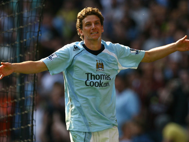 Elano of Manchester City celebrates scoring his team's third goal during the Barclays Premier League match between Manchester City and West Bromwich Albion at the City of Manchester Stadium on April 19, 2009