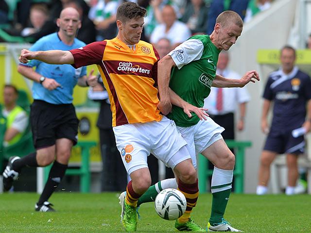Motherwell's Iain Vigurs and Hibernian's Scott Robertson battle for the ball on August 4, 2013