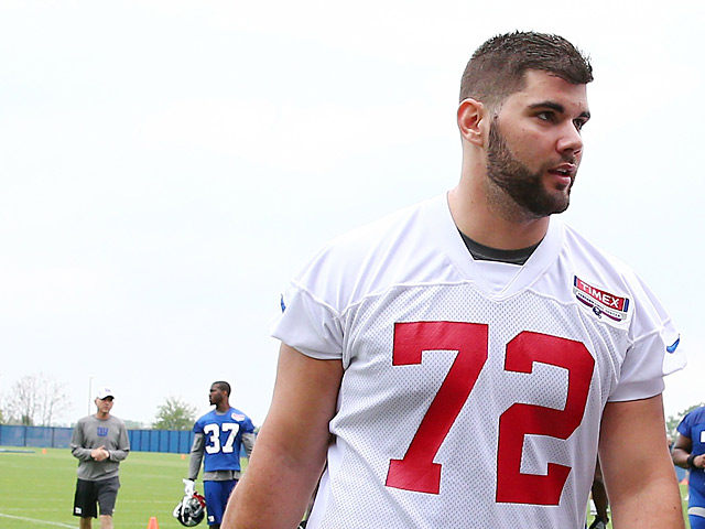 New York Giants' Justin Pugh walks off the field during training on May 11, 2013