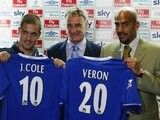 Claudio Ranieri stands between new Chelsea signings Joe Cole and Juan Sebastian Veron in 2003.