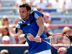 Ernests Gulbis in action against Andy Murray during the Rogers Cup on August 8, 2013