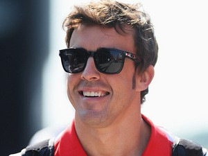 Ferrari driver Fernando Alonso smiles ahead of the final practise session of the Hungarian Grand Prix on July 27, 2013