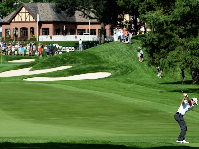 Adam Scott plays a shot during a warm-up round for the US PGA Championship at Oak Hill on August 5, 2013