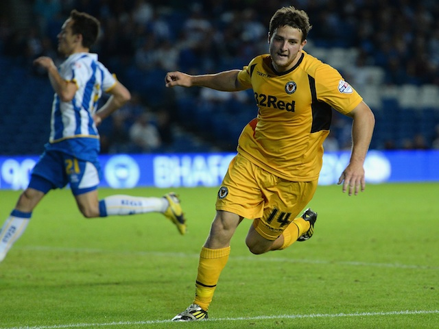 Newport's Conor Washington wheels away after scoring against Brighton on August 6, 2013