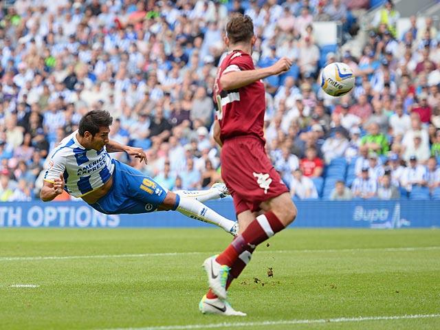 Brighton's Leonardo Ulloa heads in the opening goal against Derby on August 10, 2013