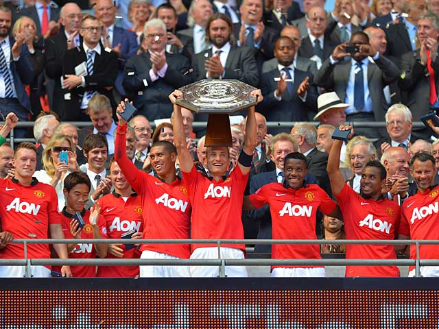 Manchester United's Nemanja Vidic lifts the Community Shield after beating Wigan 2-0 at Wembley on August 11, 2013