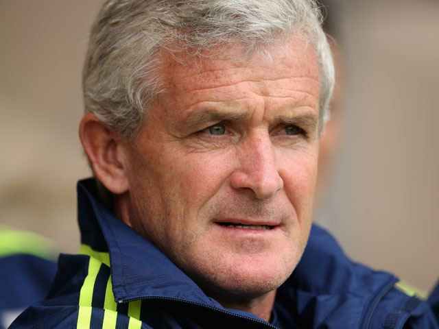 Stoke City manager Mark Hughes watches his new team during the pre season friendly match between Wrexham AFC and Stoke City on August 4, 2013
