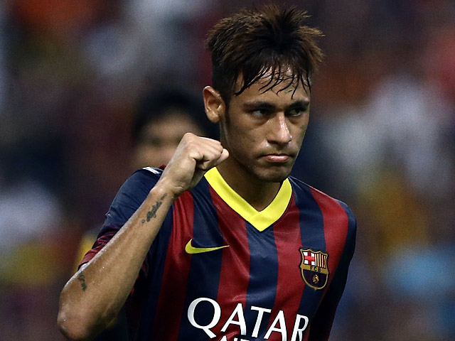 Barcelona's Neymar celebrates after scoring his team's second goal against Malaysia XI during a friendly match on August 10, 2013