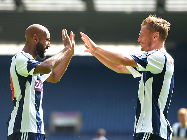 West Brom's Markus Rosenberg is congratulated by team mate Nicholas Anelka after scoring against Bologna during a friendly match on August 10, 2013