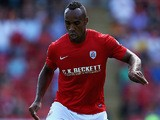 Barnsley's Chris O'Grady in action against Wigan on August 3, 2013