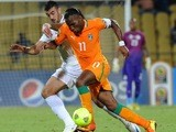 Algeria defender Essaid Belkalem battles with Didier Droga of the Ivory Coast during the Africa Cup of Nations of January 30, 2013