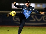 France national football team's midfielder Etienne Capoue kicks the ball during a training session, on February 4, 2013