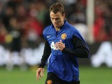 Jonny Evans controls the ball during a Manchester United training session at Allianz Stadium on July 19, 2013
