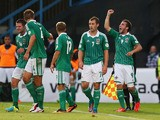 Martin Paterson of Northern Ireland celebrates after scoring the opening goal during the FIFA 2014 World Cup Group F Qualifier match between Northern Ireland and Russia at Windsor Park on August 14, 2013
