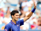 Novak Djokovic waves to the crowd as he celebrates his win against David Goffin during the Western & Southern Open on August 15, 2013
