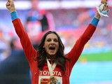 Yelena Isinbayeva on the podium after receiving her gold medal for the women's pole vault during the World Championships on August 15, 2013