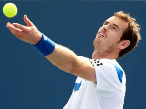Andy Murray of Grerat Britain serves to Julien Benneteau of France during the Western & Southern Open on August 15, 2013