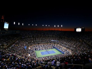 The sun sets as spectators inside Arthur Ashe Stadium watch the men's singles final match between Andy Murray of Great Britain and Novak Djokovic of Serbia on Day Fifteen of the 2012 US Open at USTA Billie Jean King National Tennis Center on September 10,