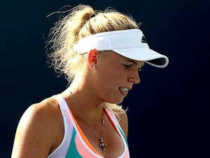 Caroline Wozniacki in action against Monica Niculescu during the Western & Southern Open on August 14, 2013