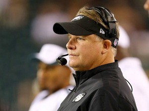 Head coach Chip Kelly of the Philadelphia Eagles looks on from the sideline in the second half against the Carolina Panthers on August 15, 2013