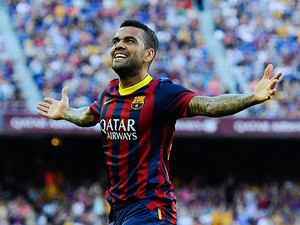 Barcelona's Dani Alves celebrates after scoring his team's third goal against Levante on August 18, 2013