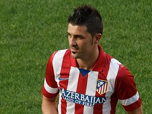 David Villa in action during his presentation as a new Atletico de Madrid player at Estadio Vicente Calderon on July 15, 2013