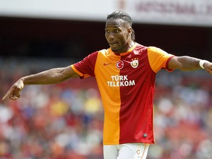 Galatasaray's Ivorian striker Didier Drogba gestures during the pre-season friendly football match between Galatasaray and FC Porto at The Emirates Stadium in north London on August 3, 2013